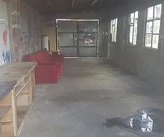 FOR RENT!! Garage and part of yard.